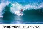 riding the waves. costa rica ... | Shutterstock . vector #1181719765