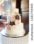 white threee tiered wedding... | Shutterstock . vector #1181745445