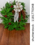 A Christmas Wreath With Cedar...