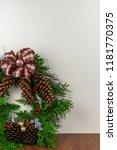 A Christmas Wreath With Cedar...
