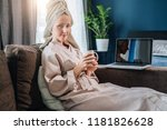 young woman in bathrobe and... | Shutterstock . vector #1181826628