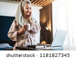young woman in bathrobe and... | Shutterstock . vector #1181827345