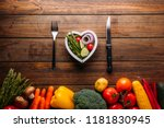 top view of a wooden table with ...   Shutterstock . vector #1181830945