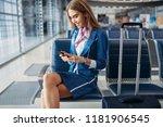 stewardess using phone in... | Shutterstock . vector #1181906545