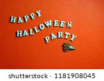 Small photo of Inscription HAPPY HALLOWEEN PARTY made of wooden letters on an orange background. The claw of the monster lies next to the words in the form of waves. Copy space.