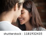 Stock photo head shot of young affectionate romantic couple in love close up portrait of attractive brunette 1181932435