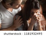 Small photo of Unhappy couple. Girl crying guy calms her. Husband after the quarrel apologize, interruption of unwanted pregnancy, miscarriage. Friend support girlfriend after disagreement with a loved one, divorce