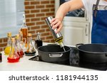 woman pouring cooking oil from... | Shutterstock . vector #1181944135