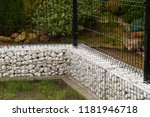 a steel fence combined with a... | Shutterstock . vector #1181946718