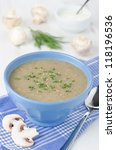 Bowl of mushroom soup with fresh mushrooms and dill close up - stock photo