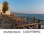 table and chairs by the sea | Shutterstock . vector #1181978992