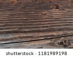 Close view of an old cracked and weathered waterlogged board.