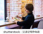 businesswoman use mobile phone... | Shutterstock . vector #1181989468