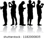 silhouettes of people making... | Shutterstock .eps vector #1182000835