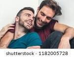 happy gay couple embraced ... | Shutterstock . vector #1182005728