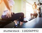 fitness girl dumbbell to... | Shutterstock . vector #1182069952