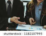 business adviser working with... | Shutterstock . vector #1182107995