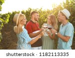 friends drinking wine and... | Shutterstock . vector #1182113335