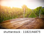 old rustic wooden table in the... | Shutterstock . vector #1182146875