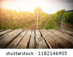 old rustic wooden table in the... | Shutterstock . vector #1182146905