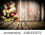 wooden destroyed table by the... | Shutterstock . vector #1182152572