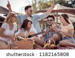 friends drinking beers and... | Shutterstock . vector #1182165808