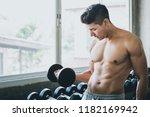 fitness asian man doing... | Shutterstock . vector #1182169942