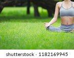 fitness asian woman doing yoga... | Shutterstock . vector #1182169945