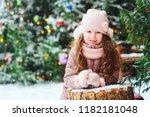 christmas portrait of happy kid ... | Shutterstock . vector #1182181048