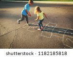 Kids Playing Hopscotch On...