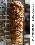 shawarma meat being cut before... | Shutterstock . vector #1182206188