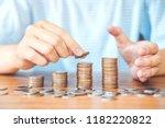 saving money concept man hand... | Shutterstock . vector #1182220822