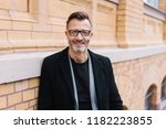attractive stylish middle aged... | Shutterstock . vector #1182223855