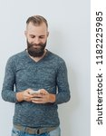 attractive bearded man smiling... | Shutterstock . vector #1182225985