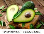 organic raw green avocados... | Shutterstock . vector #1182235288