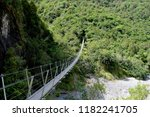 suspension bridge in rain... | Shutterstock . vector #1182241705