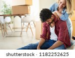 tired couple with boxes moving... | Shutterstock . vector #1182252625