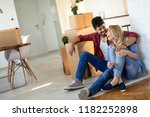 young couple unpacking... | Shutterstock . vector #1182252898