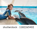kid and dolphin. girl with... | Shutterstock . vector #1182265402