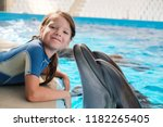 kid and dolphin. girl with... | Shutterstock . vector #1182265405