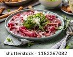 beef carpaccio on black plate... | Shutterstock . vector #1182267082