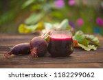 beet  juice in glass on wooden... | Shutterstock . vector #1182299062