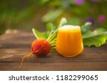 yellow beet  juice in glass on... | Shutterstock . vector #1182299065