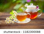 green tea with chamomile in... | Shutterstock . vector #1182300088