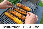 grilled corn grilled on fire.... | Shutterstock . vector #1182310555
