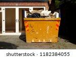 yellow rubbish skip. selective... | Shutterstock . vector #1182384055