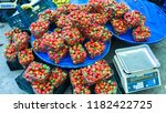 strawberries on the bench or... | Shutterstock . vector #1182422725