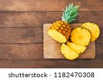 pineapple on wood texture... | Shutterstock . vector #1182470308