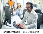 young male technical support... | Shutterstock . vector #1182481345