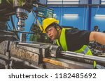 asian machinist in safety suit... | Shutterstock . vector #1182485692